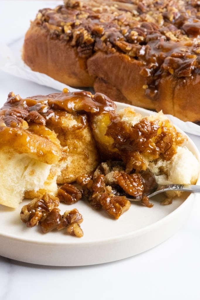 maple bourbon pecan caramel cinnamon rolls
